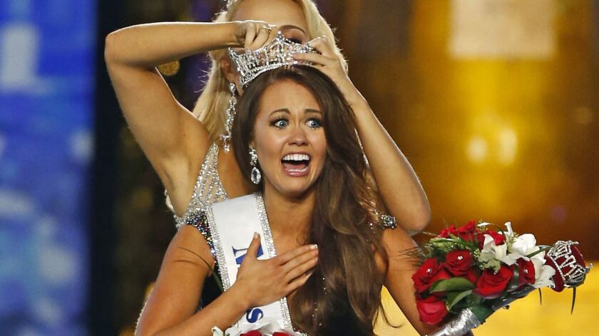 Miss North Dakota Cara Mund reacts after being named Miss America during the 2018 pageant in Atlantic City.
