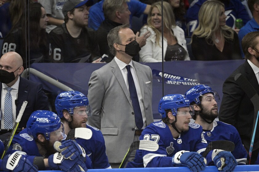 Tampa Bay Lightning head coach Jon Cooper watches from the bench during the first period in Game 2 of the NHL hockey Stanley Cup finals against the Montreal Canadiens, Wednesday, June 30, 2021, in Tampa, Fla. (AP Photo/Phelan Ebenhack)