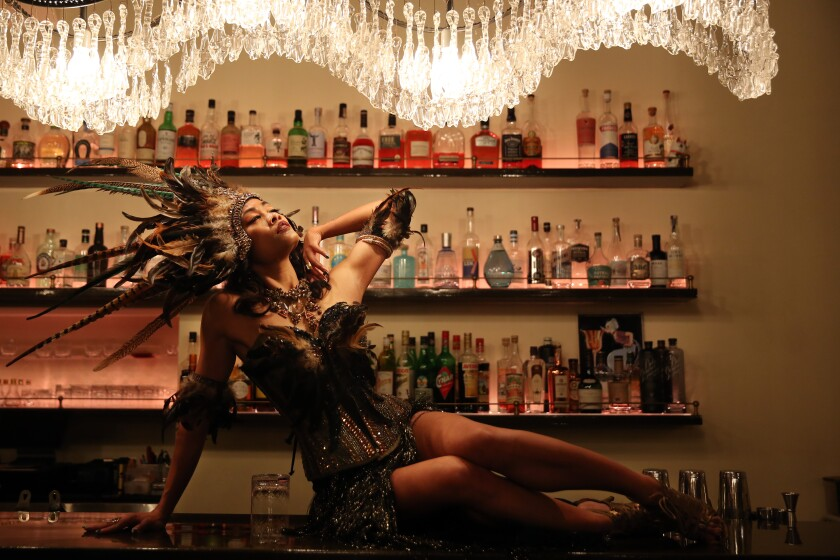 "Mizon Garde pauses for a portrait at Genever, where she performs in an all-Filipina burlesque show called ""Burlesque Las FilipinX."""