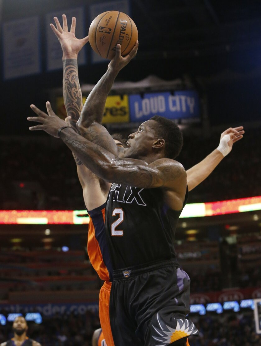 Phoenix Suns guard Eric Bledsoe (2) shoots in front of Oklahoma City Thunder center Steven Adams, rear, in the second quarter of an NBA basketball game in Oklahoma City, Sunday, Nov. 8, 2015. (AP Photo/Sue Ogrocki)