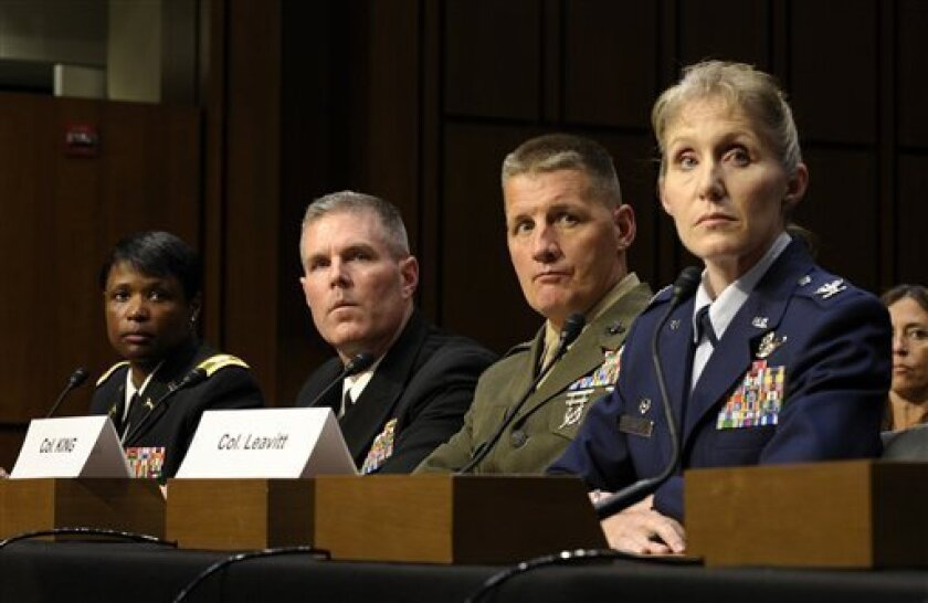 From left, Commander of the 202nd Military Police Group Col. Donna W. Martin; Commodore of Destroyer Squadron TWO Navy Capt. Stephen J. Coughlin; Commander of Combat Logistics Regiment 15 Marine Col. Tracy W. King; and Commander, 4th Fighter Wing Air Force Col. Jeannie M. Leavitt, testify on Capitol Hill in Washington, Tuesday, June 4, 2013, before the Senate Armed Services Committee hearing on pending legislation regarding sexual assaults in the military. (AP Photo/Susan Walsh)