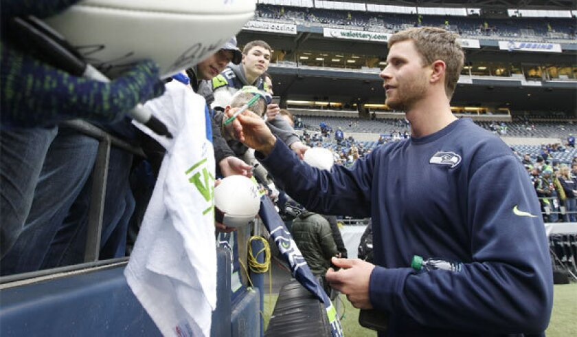 Seattle kicker Steven Hauschka signs autographs before the NFC championship game.
