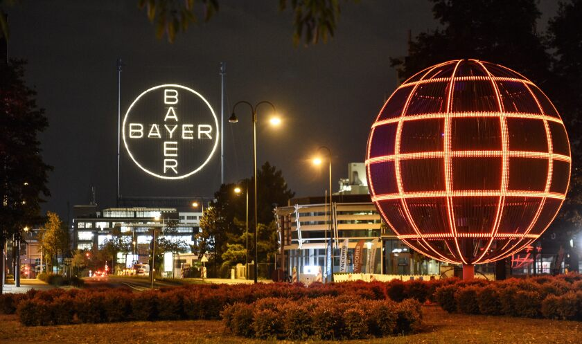 FILE -- This Aug. 9, 2019 file photo shows the Bayer logo at the main chemical plant of German Bayer AG in Leverkusen, Germany. Bayer subsidiary Monsanto has pleaded guilty to spraying a banned pesticide on research crops on the Hawaii island of Maui in 2014, prosecutors said. (AP Photo/Martin Meissner)