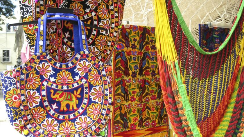 MERIDA, MEXICO - Colorful Yucatecan crafts for sale at a street market.