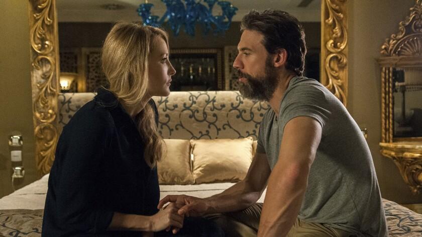 "Jennifer Finnigan and Adam Rayner in ""Tyrant"" on FX."