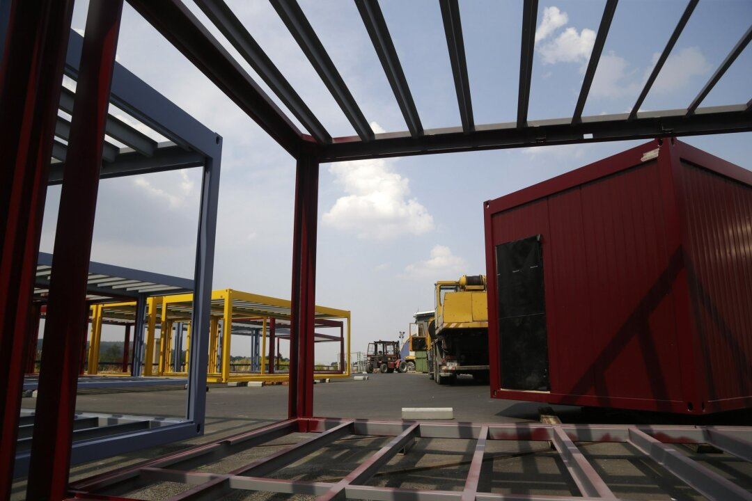 Modular containers are placed at a plant in the village of Supikovice, Czech Republic, Tuesday, Aug. 11, 2015. The company which belongs to the modular division of the Paris-based Touax Group has been recently benefiting from orders from Germany that uses these modular like buildings to house thous