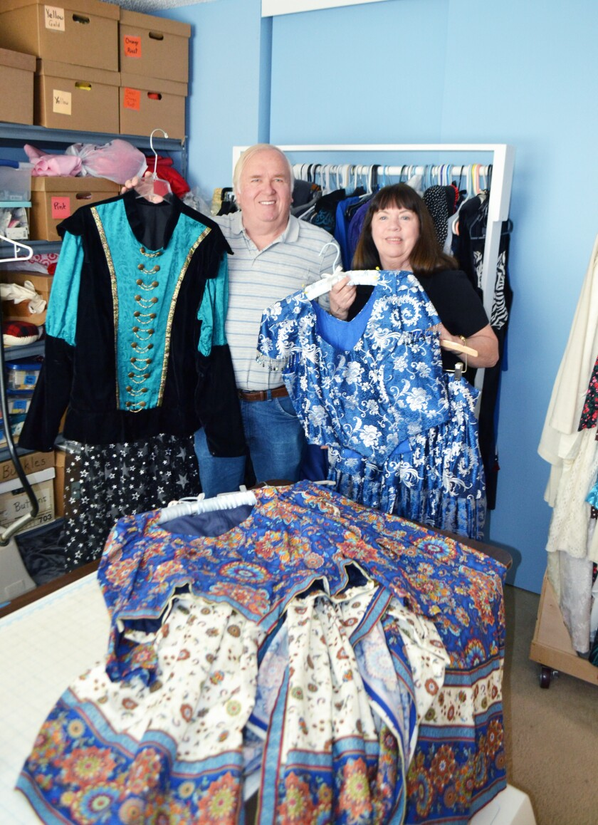 Mike Davis and Susan Casey Davis in their home's work room (originally the master bedroom) with some of their costumes.