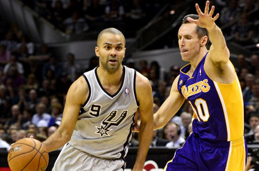 Lakers point guard Steve Nash tries cut off a drive by Spurs point guard Tony Parker in the second half of Game 1 on Sunday afternoon in San Antonio.