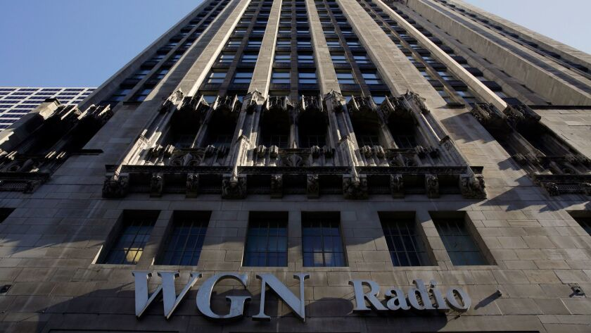 A sign for WGN Radio, part of Tribune Media, appears on the side of Tribune Tower in downtown Chicago.