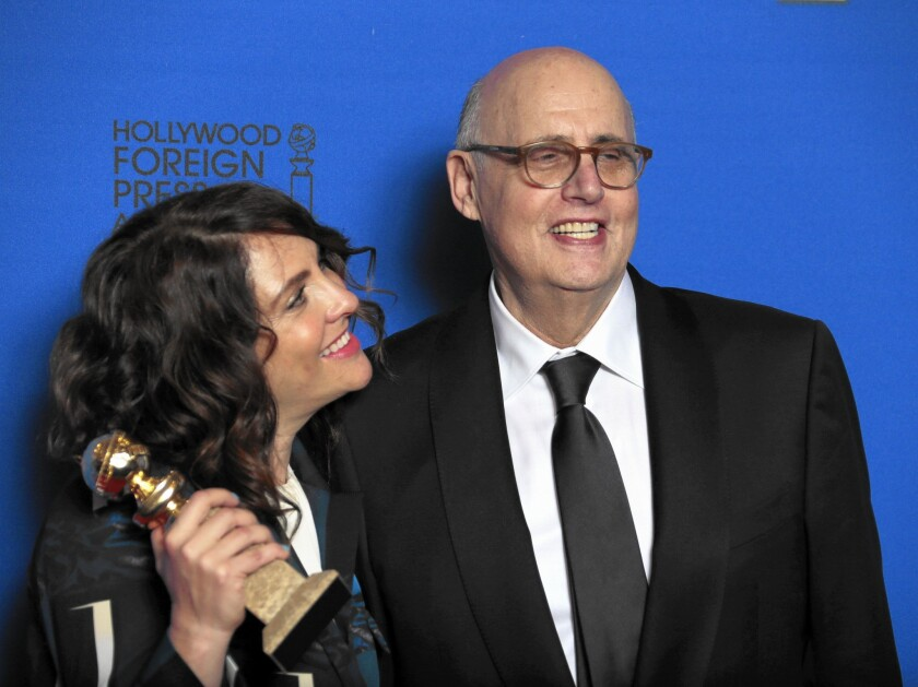 """Jill Soloway holds """"Transparent's"""" Golden Globe for comedy or musical television series beside the Amazon show's star, Jeffrey Tambor, who also won an award."""