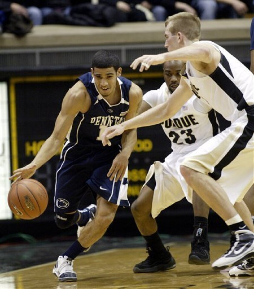 Penn State's Talor Battle, left, tries to drive past Purdue's Lewis Jackson (23) and Robbie Hummel, right, during the first half of an NCAA college basketball game in West Lafayette, Ind., Sunday, Jan. 31, 2010. (AP Photo/Tom Strattman)