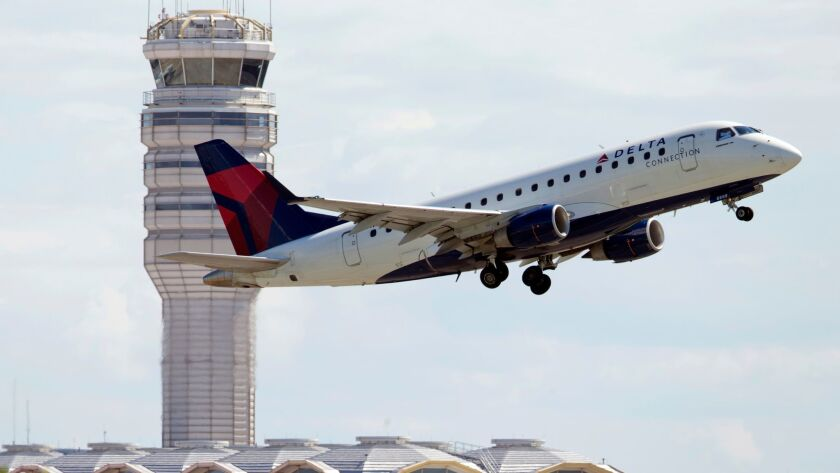 FILE - In this July 28, 2014 file photo, a Delta Air Lines jet takes off from Ronald Reagan Washingt