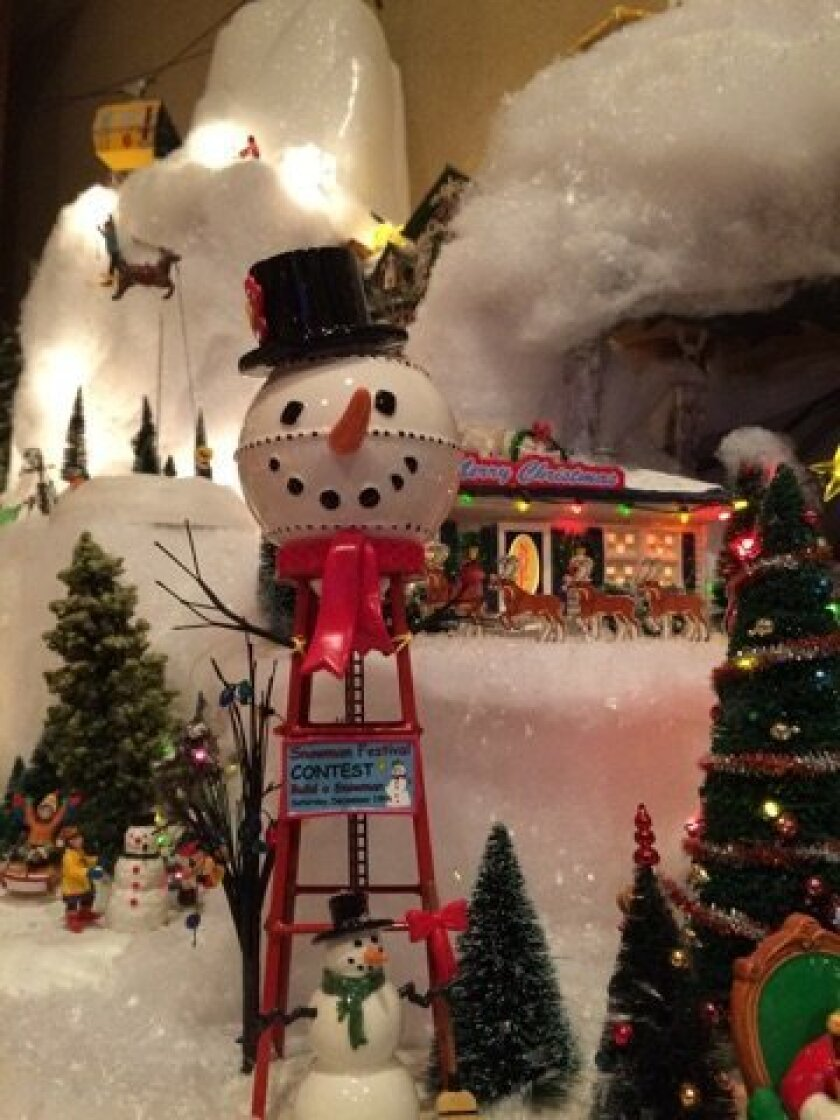 A snowman water tower is part of the display.