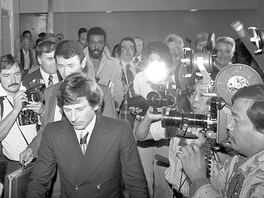 Roman Polanski leaves court in 1977