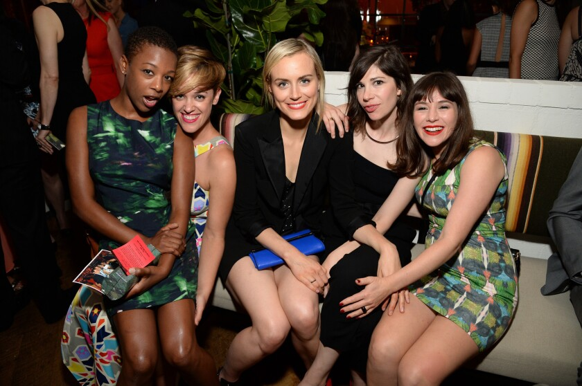 """""""Orange Is the New Black"""" actress Samira Wiley, left, gets close with writer Lauren Morelli at an Emmy-nominee event also attended by """"OITNB"""" cast members Taylor Schilling, center, and Yael Stone, right, as well as """"Portlandia"""" composer Carrie Brownstein."""
