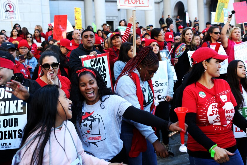 Teachers and their supporters fill Grand Park during a rally after a tentative agreement wath LAUSD on smaller classes, new community schools, nurses and a raise.