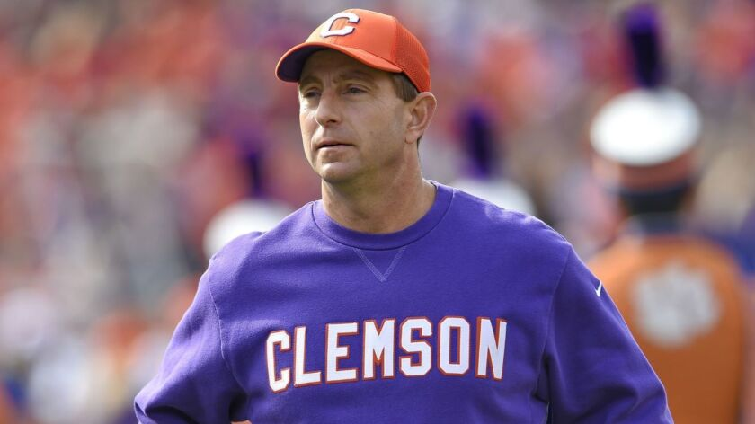 FILE - In this Saturday, Nov. 18, 2017 file photo, Clemson head coach Dabo Swinney watches before th