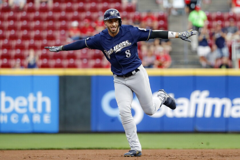 FILE- In this Sept. 25, 2019, file photo, Milwaukee Brewers' Ryan Braun runs the bases after hitting a grand slam off Cincinnati Reds starting pitcher Tyler Mahle during the first inning of a baseball game in Cincinnati. Braun, the Brewers' home run leader whose production was slowed by injuries during the second half of his 14-year career, announced his retirement on Tuesday, Sept. 14, 2021. Braun hasn't played all season and said during spring training that he was leaning toward retirement. (AP Photo/John Minchillo, File)