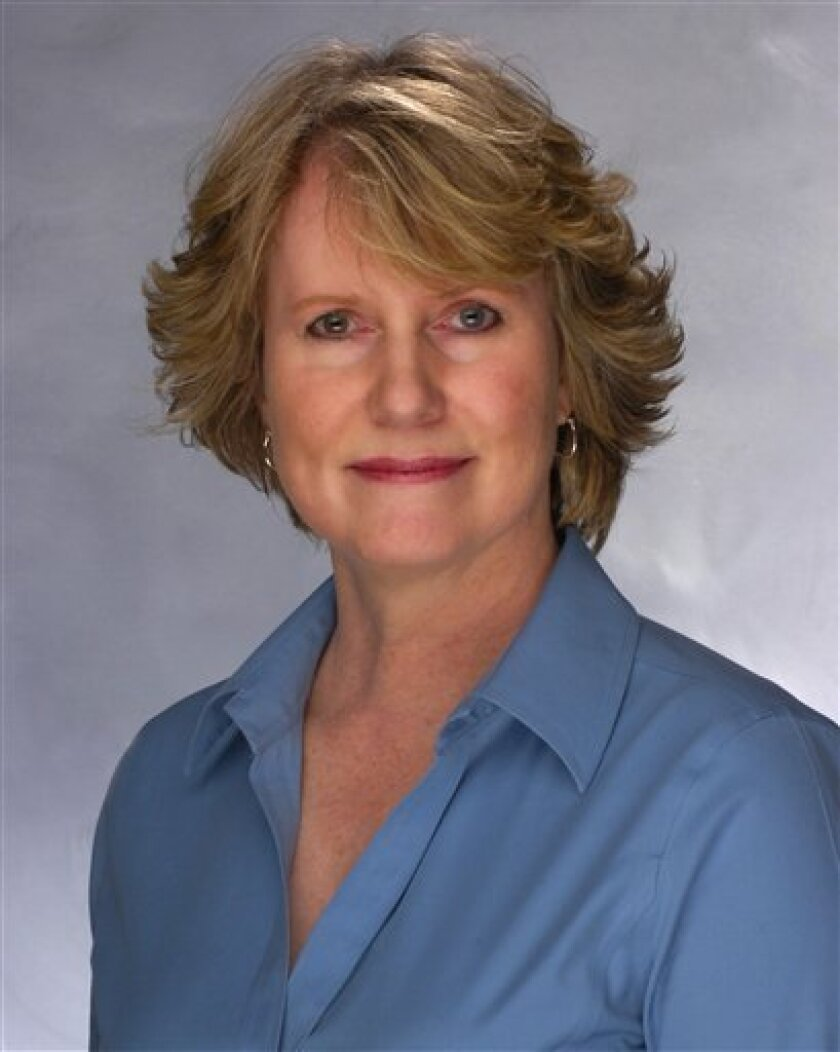 This May 20, 2010 photo provided by the Baltimore Sun shows Sun editor Mary Corey. Corey, the first woman to hold the top editorial post at The Baltimore Sun newspaper, died Tuesday, Feb. 26, 2013 of breast cancer. She was 49. (AP Photo/The Baltimore Sun, Robert K. Hamilton) MANDATORY CREDIT: BALTI