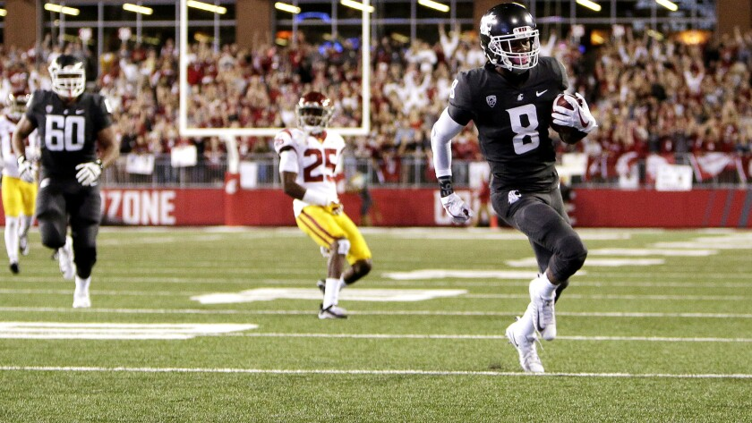 Washington State wide receiver Tavares Martin Jr. breaks free for a touchdown in the first half.