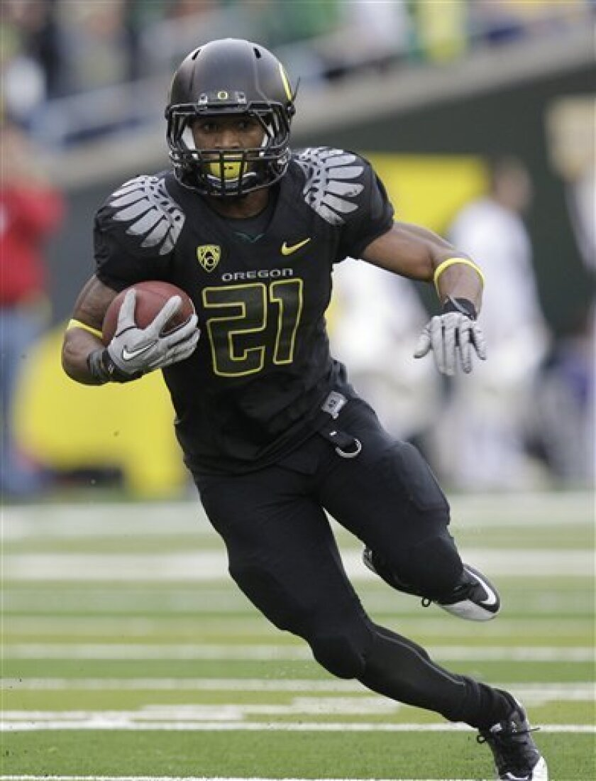 FILE - This Nov. 6, 2010, file photo shows Oregon running back LaMichael James carrying the ball during the third quarter of an NCAA college football game against Washington, in Eugene, Ore.  The small yet speedy sophomore is among the four finalists for the Heisman Trophy. (AP Photo/Rick Bowmer, F