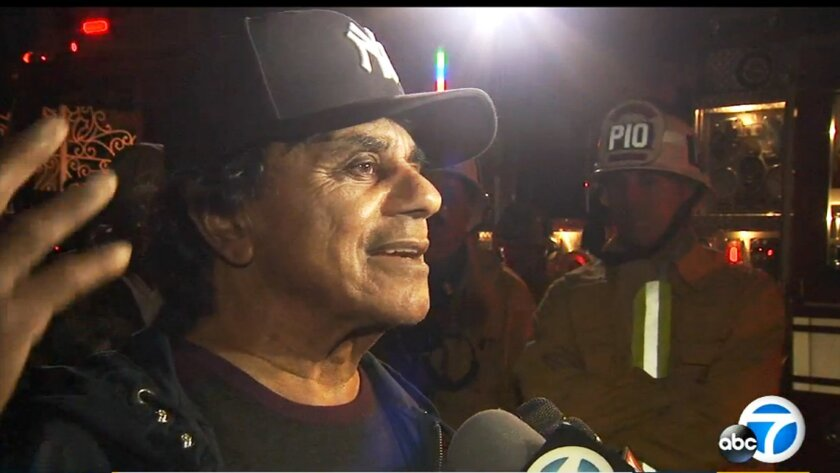 In this Monday, Nov. 2, 2015 still frame from video provided by KABC-TV, singer Johnny Mathis talks to reporters outside his heavily fire-damaged home in the Hollywood Hills of Los Angeles. The 80-year-old singer had just flown back to Los Angeles to learn that his home of 56 years caught fire. He