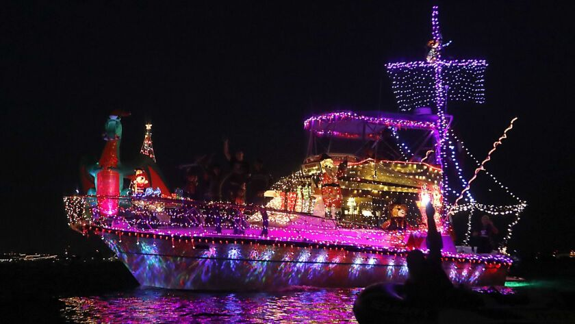 Celebrating boaters show off their finest holiday light displays at the annual Parade of Lights on San Diego Bay.