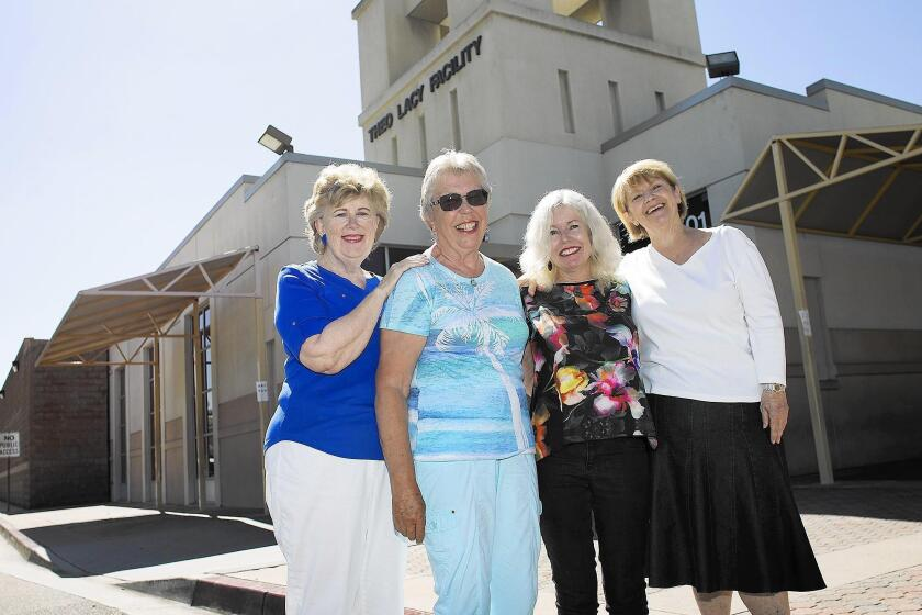 Friends of Orange County Detainees leadership team members and volunteers — from left, Peggy Thompson, Beverly Huff, Ellen DeYoung and Sheryl Hagen — stand in front of the Theo Lacy Facility in Orange.