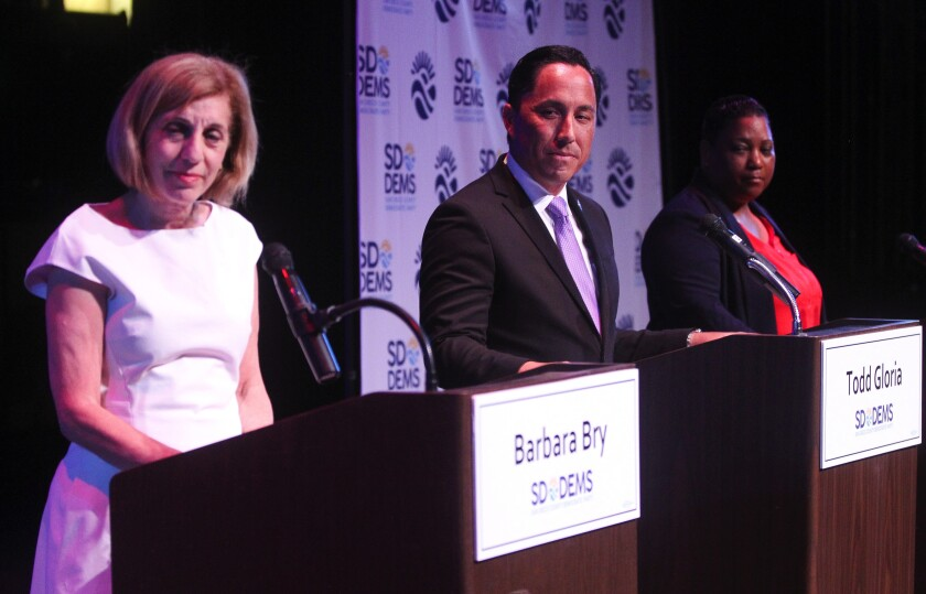 Mayoral candidates Barbara Bry, Todd Gloria and Tasha Williamson spoke in front of about 150 people at a recent forum hosted by the San Diego County Democratic Party.