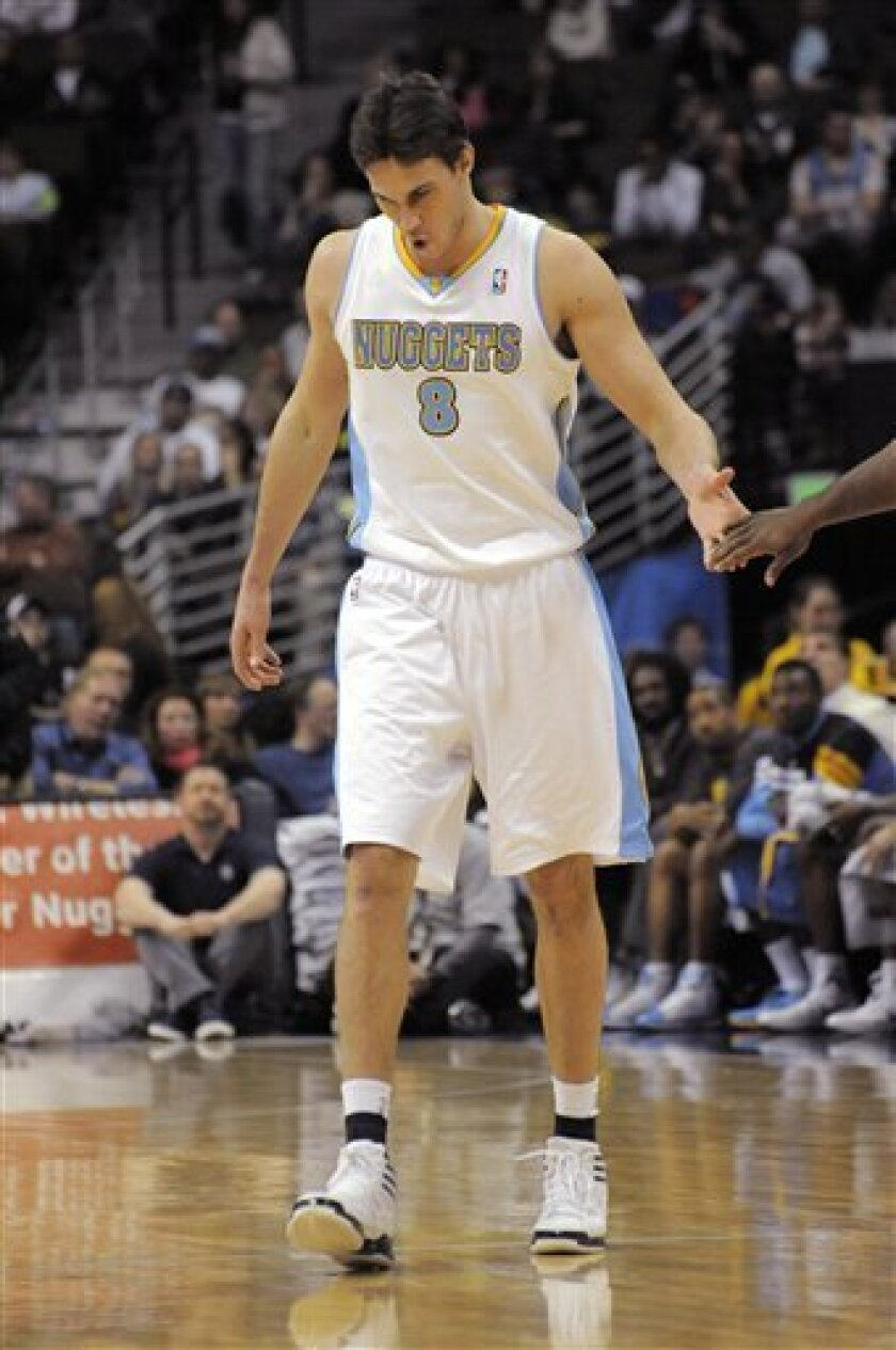 Denver Nuggets forward Danilo Gallinari (8) from Italy walks gingerly back to the line to shoot free throws after injuring his ankle against the Houston Rockets during the third quarter of an NBA basketball game on Monday, Feb. 6, 2012, in Denver. (AP Photo/Jack Dempsey)