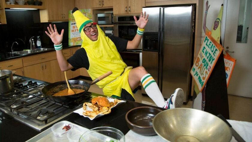 Nguyen Tran of Starry Kitchen, in his signature banana suit, shows how to make Singaporean chili cra
