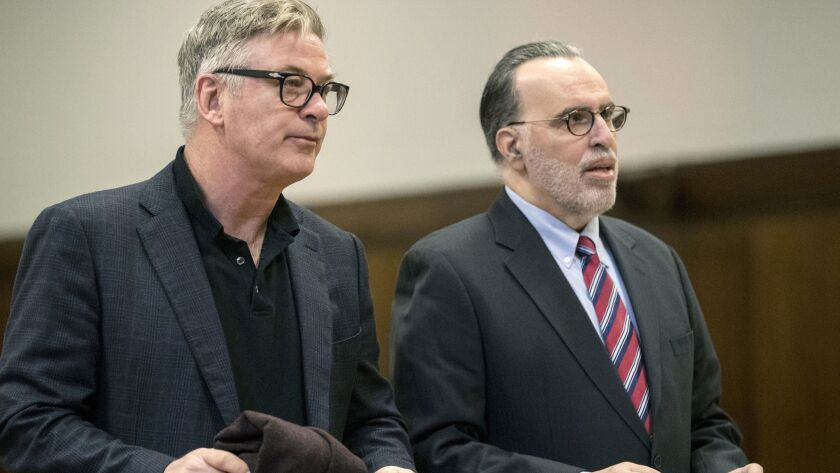 Actor Alec Baldwin, left, stands with his attorney during a court hearing in New York on Wednesday.