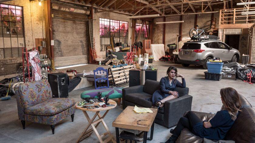 NOVEMBER 29, 2017 OAKLAND, CA. Misha Naiman, center, speaks with Tanya Rutherford at a warehouse spa