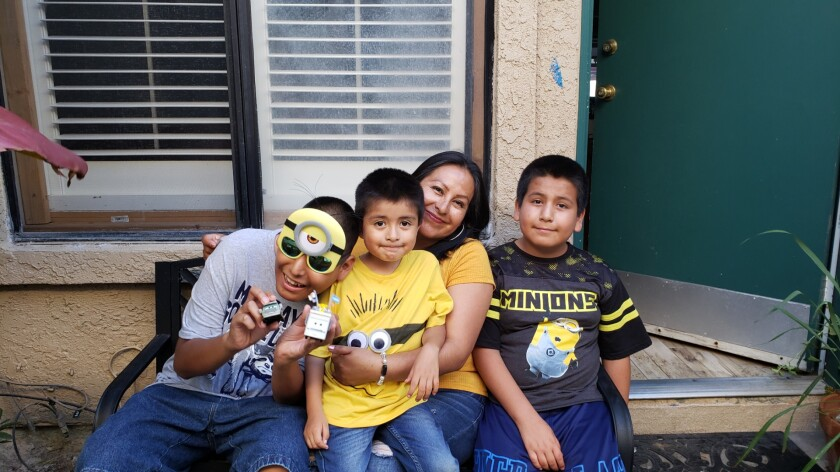 Manny with his mother and cousins