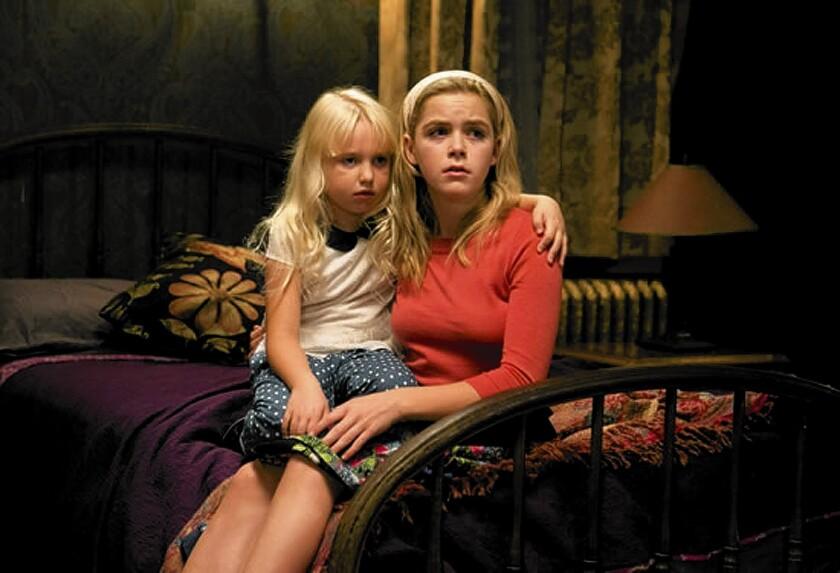 "Ava Telek, left, and Kiernan Shipka star in ""Flowers in the Attic."""