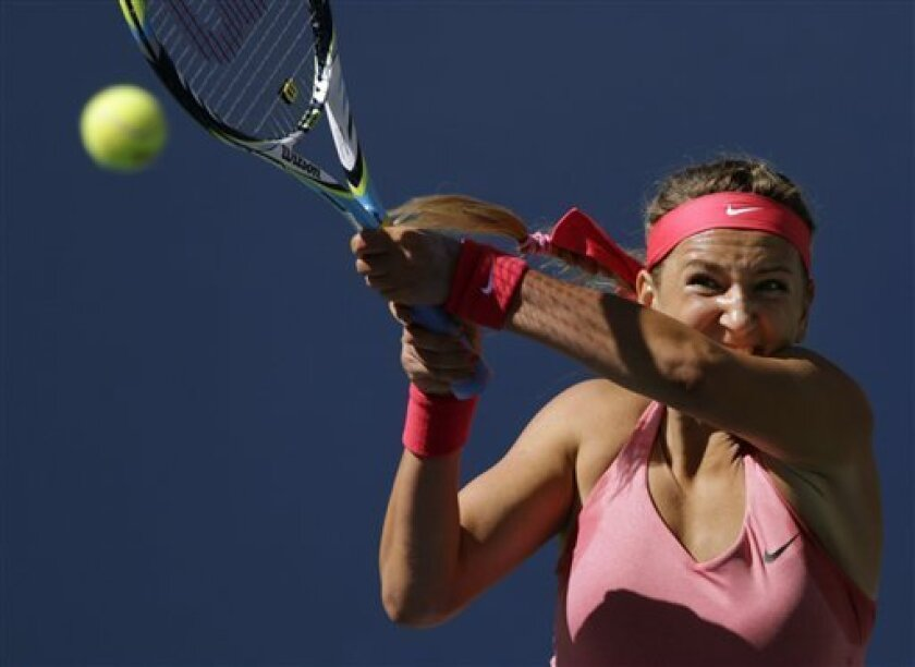 Victoria Azarenka, of Belarus, returns a shot to Flavia Pennetta, of Italy, during the semifinals of the 2013 U.S. Open tennis tournament, Friday, Sept. 6, 2013, in New York. (AP Photo/Charles Krupa)