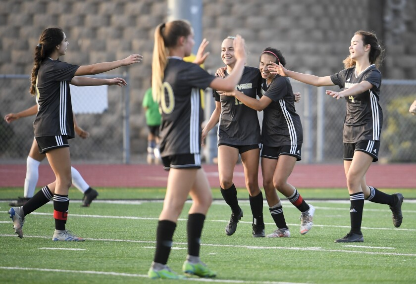 Westview players celebrate after beating Alta Loma 2-0 in the CIF girls soccer championship game against Alta Loma.