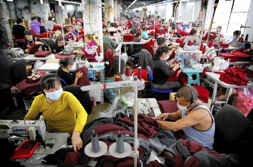 American Apparel employees are involved in cutting, sewing and packaging garments at the company's factory in L.A.