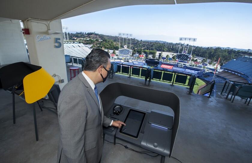 California Secretary of State Alex Padilla visits the Dodger Stadium Vote Center on Sept. 24.