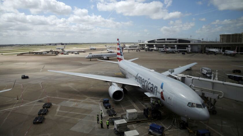 In this June 16, 2018 photo, American Airlines aircrafts are seen at Dallas-Fort Worth International