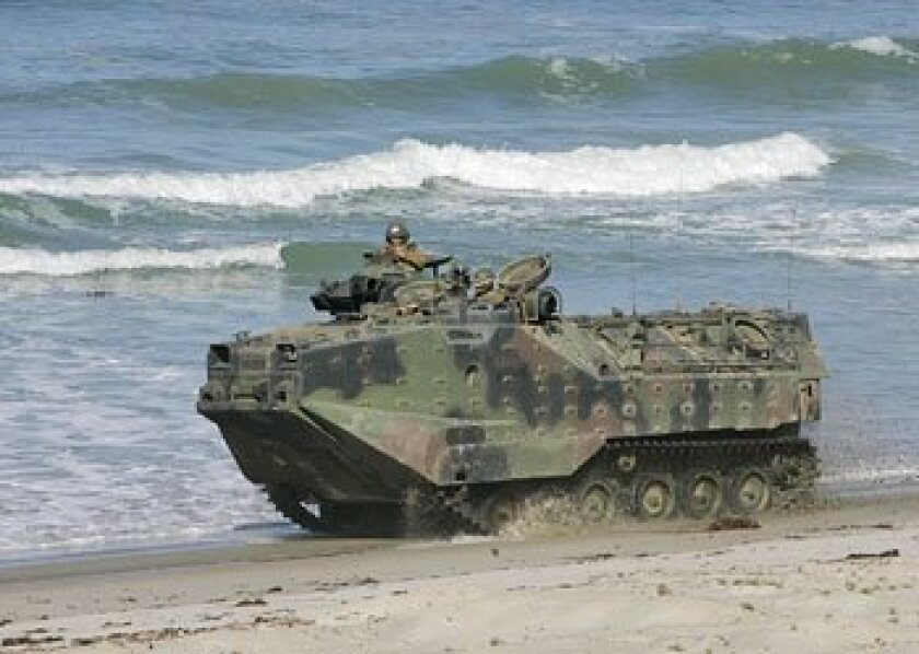 A Marine Corps amphibious vehicle kicked up sand at Camp Pendleton's Red  Beach, the site of regular military training. (Charlie Neuman /  Union-Tribune)