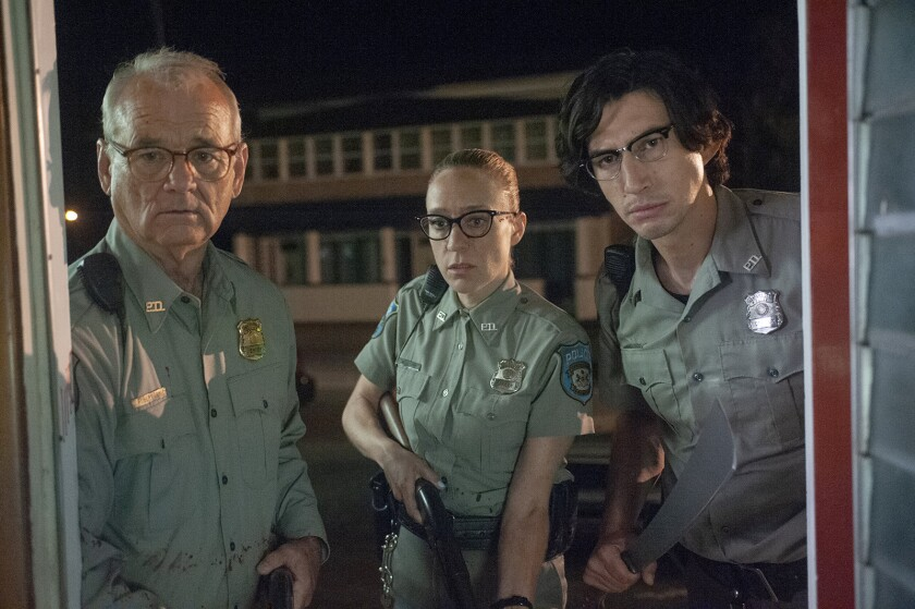 """(L to R) Bill Murray as """"Officer Cliff Robertson"""", Chlo? Sevigny as """"Officer Minerva Morrison"""" and A"""