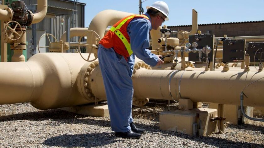 A SoCalGas worker checks a pipeline at the Aliso Canyon natural gas storage facility.