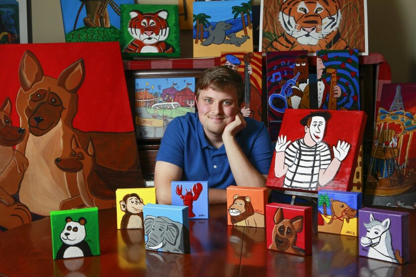 Autistic artist Joel Anderson, 23, surrounded by his paintings at his home in Fallbrook on Monday. HAYNE PALMOUR /UT San Diego/Copyright 2014 San Diego Union-Tribune, LLC