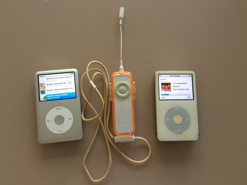 The dead-enders (from left): iPod Classic, original Shuffle, fifth generation.
