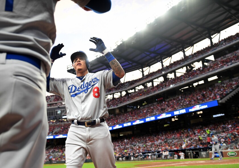 Dodgers shortstop Manny Machado celebrates after hitting a three-run home run against the Atlanta Braves in the seventh inning of Game 4 of the NLDS on Monday.