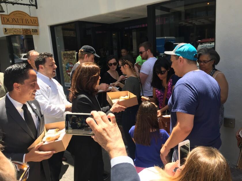 U.S. Senator Kamala Harris, and Assemblyman Todd Gloria handed out sweets in 2016