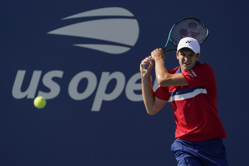 Hubert Hurkacz, of Poland, returns a shot to Andreas Seppi, of Italy, during the second round of the US Open tennis championships, Thursday, Sept. 2, 2021, in New York. (AP Photo/Seth Wenig)