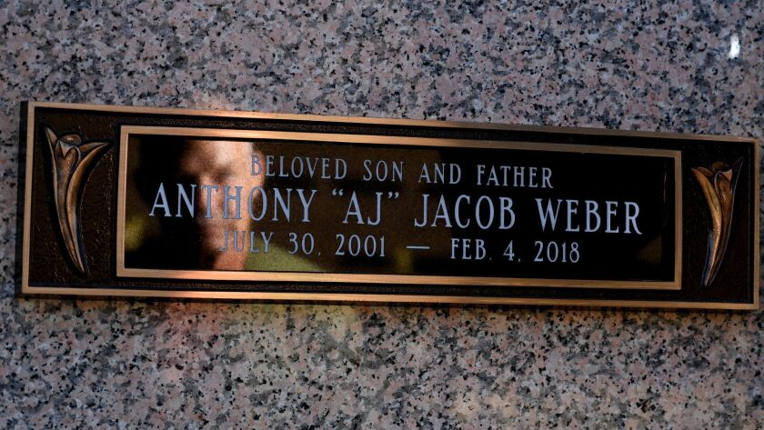 LOS ANGELES, CALIFORNIA JUNE 13, 2018-John Weber, holdong his son Anthony's glove, stands next to th