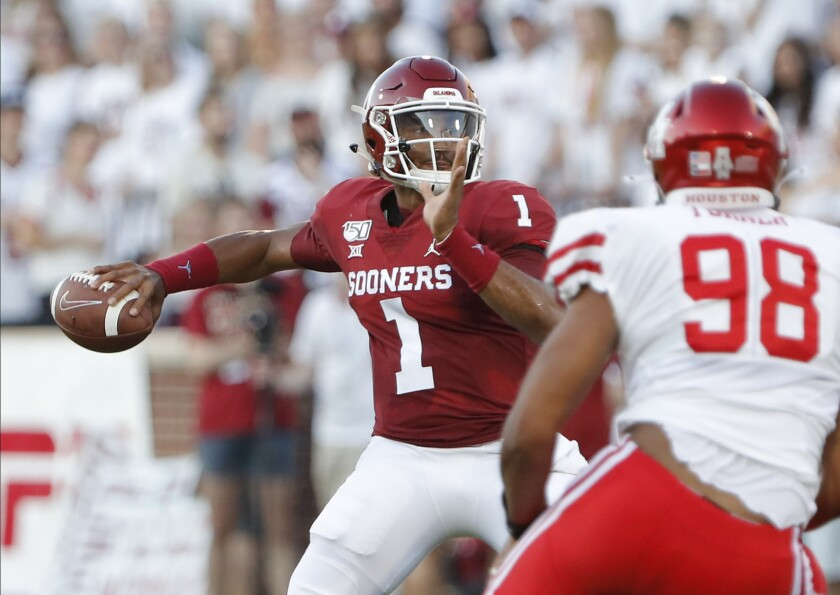 Oklahoma quarterback Jalen Hurts prepares to pass against Houston during the first half Sunday.